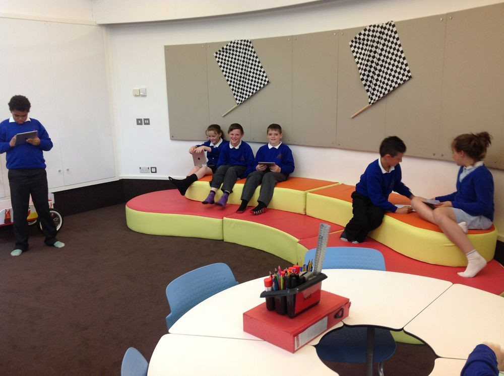 Collaborative Classroom Seating ~ Tiered cohort seating the technology is often collaborative